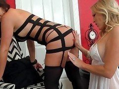 Kinky lesbians getting dressed for love-making