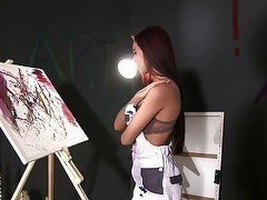 Busty beauty with cute face is a lusty painter
