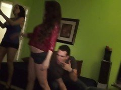Dimly lit room orgy with several horny babes
