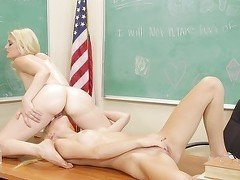 Two naughty schoolgirls making out and licking each other in the classroom